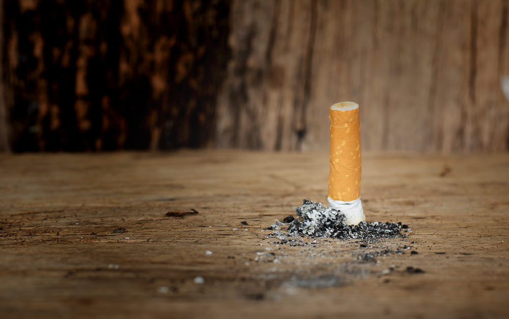 Quit smoking stamping cigarette out